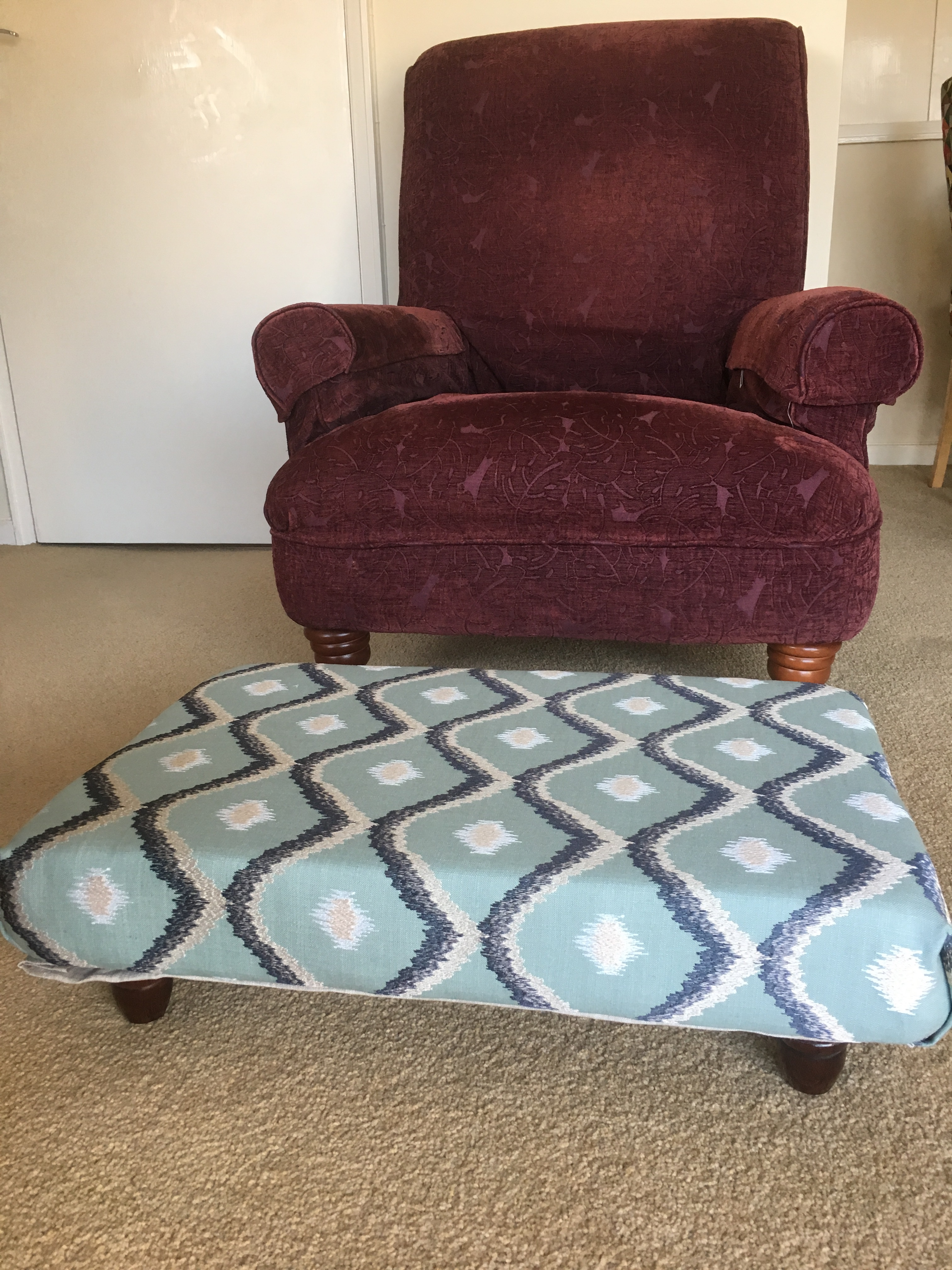 Designed and made by hand to order using interior designer fabric and wooden legs to match clients' furniture.